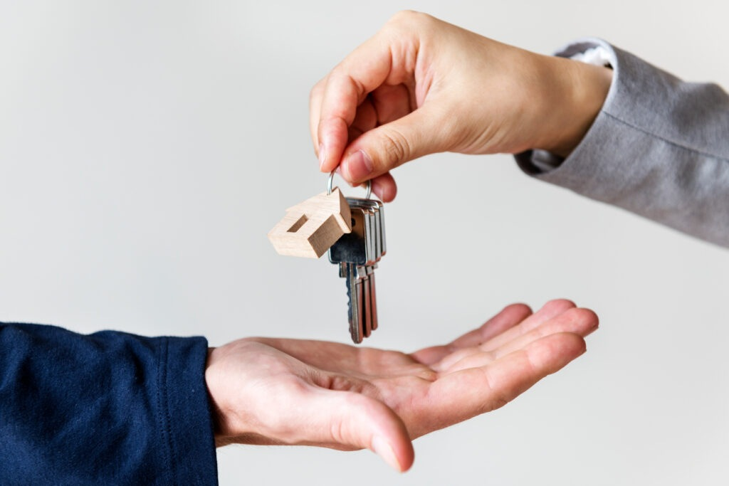Photo of keys for home in hand