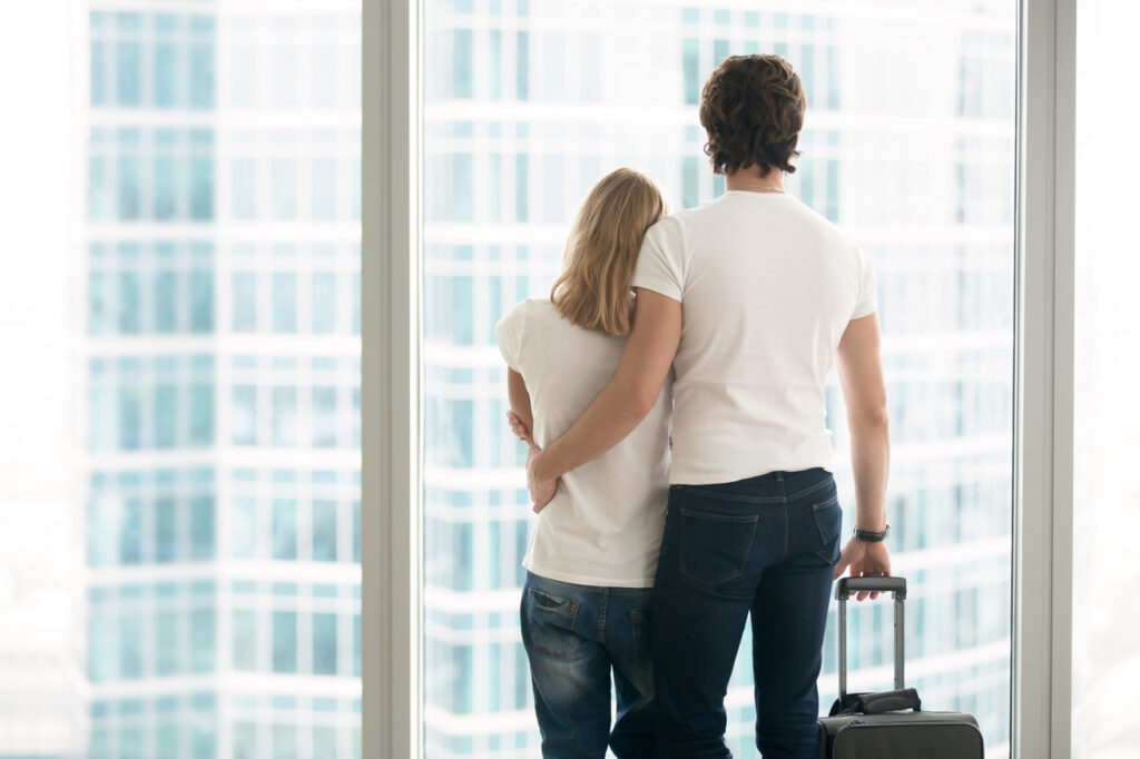 couple over looking city with luggage